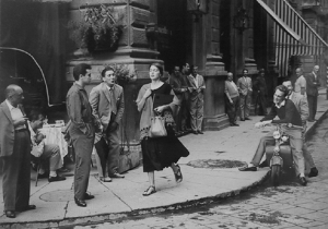 "This iconic photograph, American Girl in Italy, 1951 by Ruth Orkin, has always seemed a bit menacing to me, though I believe the photographer and human subject saw it as an expression of freedom. I've always wondered: whose freedom does it most express? I think I first saw it as an ""art poster"" and something people put on their walls as an expression of their artistic taste. It is both compelling and repulsive because it shows a woman essentially running the gauntlet. The whistling man, with his hand on his crotch can hardly be described as ""non threatening""."